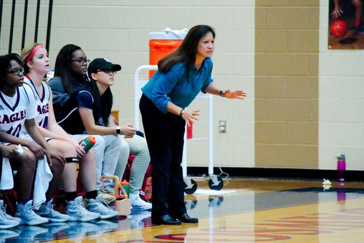 Dawson basketball coach Isabel Gomez watches as her team plays Alief Hastings Friday, Jan. 20 at Dawson High School