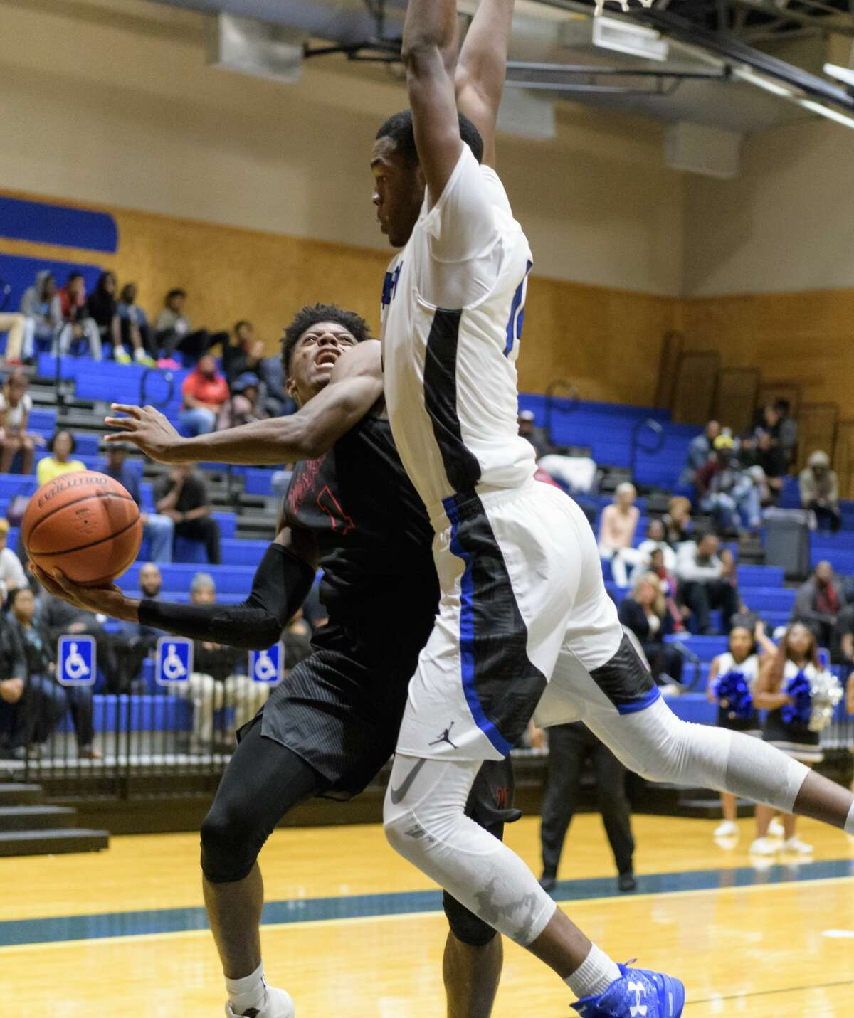 Darius McNeill (1) of the Westfield Mustangs is fouled in the second half by Anthony Nash (14) of the Dekaney Wildcats in a high school basketball game on Friday, January 20, 2017 at the Dekaney High School Gym in Houston Texas.
