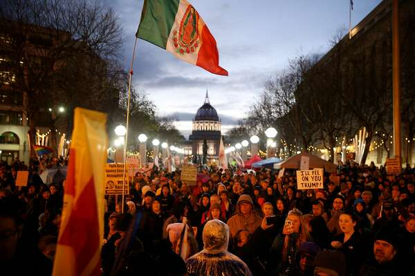 Hundreds of people rally at the United Nations Plaza on Friday, Jan. 20, 2017 in San Francisco, Calif. Hundreds of demonstrations across the country protested the presidential inauguration of Donald Trump.