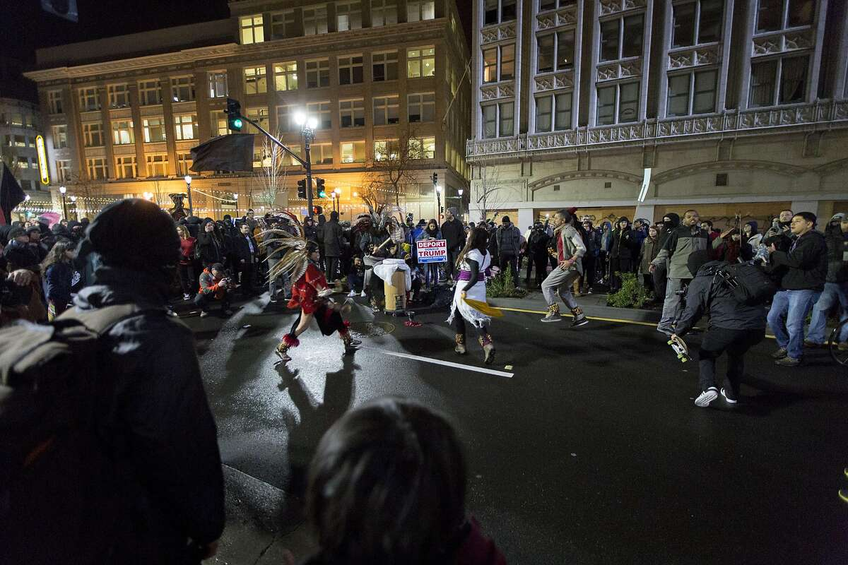 An anti-Trump rally marches around downtown Oakland, Friday, Jan. 20, 2017 in Oakland, CA.