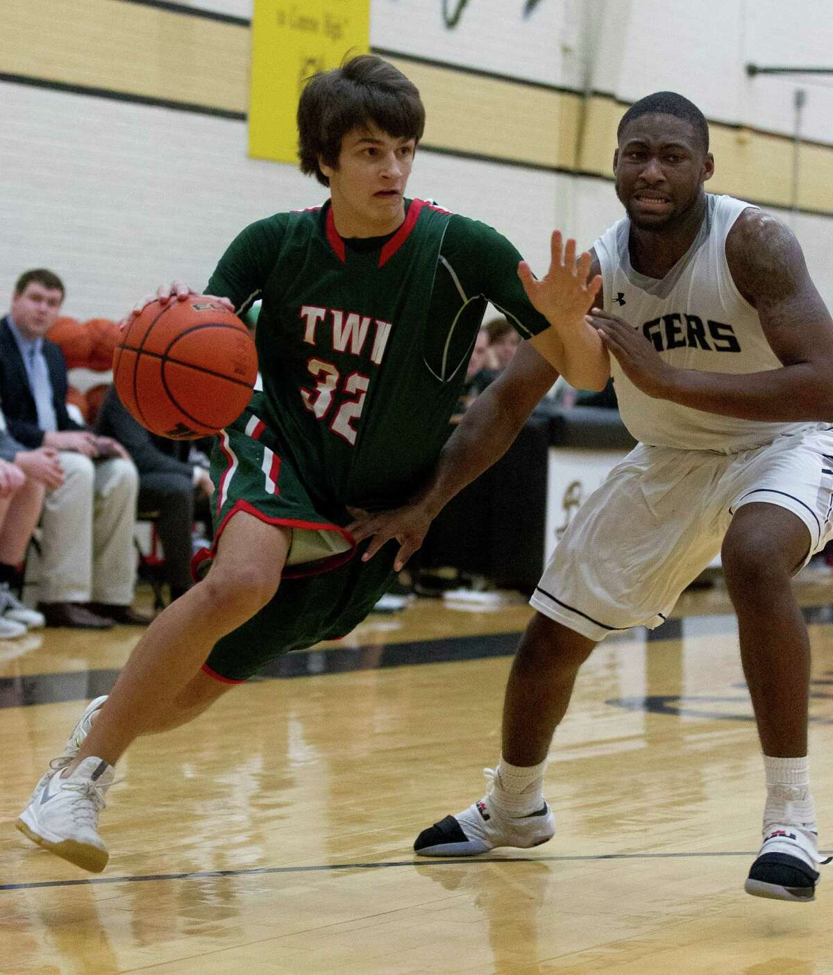 The Woodlands Charlie Zorn (32) drives toward the basket during the first quarter of a District 16-6A high school boys basketball game at Conroe High School Friday, Jan. 20, 2017, in Conroe. Conroe defeated The Woodlands 74-71 in overtime for the Tigers' first win over the Highlanders since 2008.