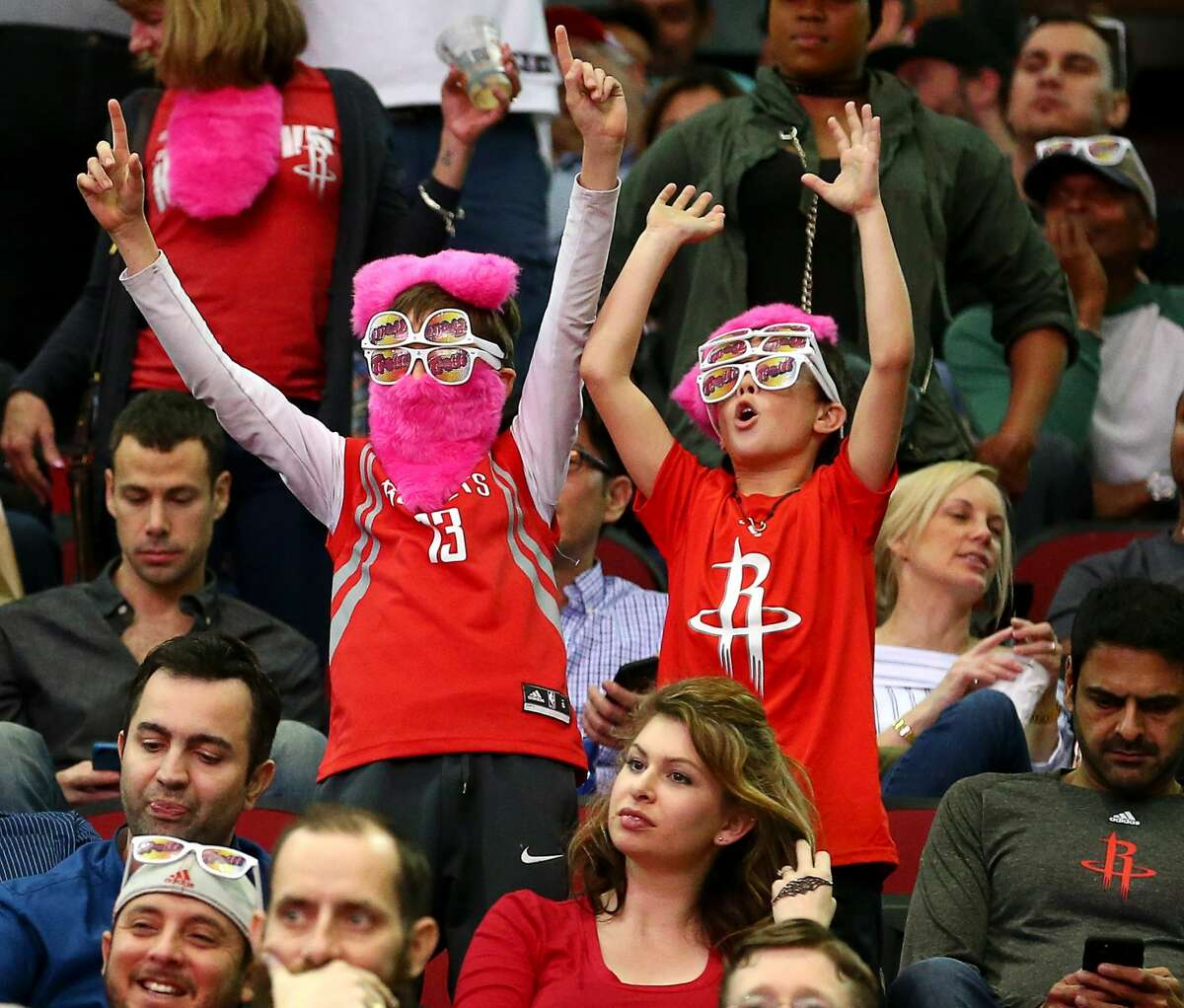 Two young fans cheer during the fourth quarter of an NBA game at the Toyota Center Friday, Jan. 20, 2017, in Houston. ( Jon Shapley / Houston Chronicle )