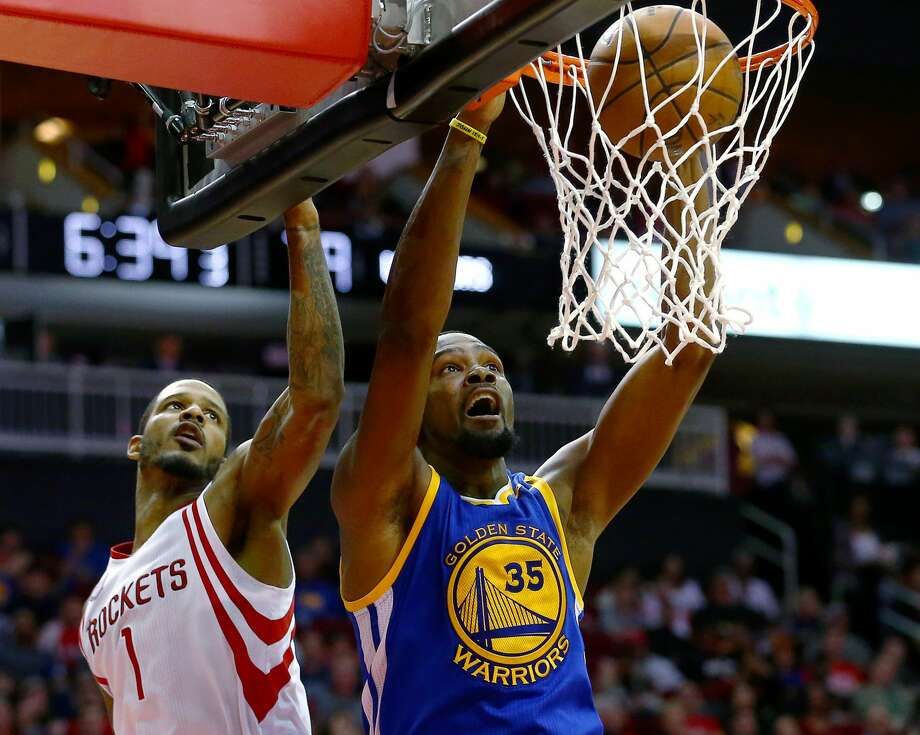 As Trevor Ariza knows, there's no simple way to stop Kevin Durant. Photo: Jon Shapley/Houston Chronicle