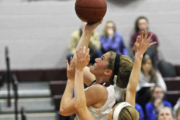 FILE PHOTO: Bethel's Lily Daniels (14) drives to the basket past Immaculate's Meghan Coyle (5) in the girls SWC basketball game between Immaculate and Bethel high schools on Friday night, December 16, 2016, at Bethel High School, in Bethel, Conn.