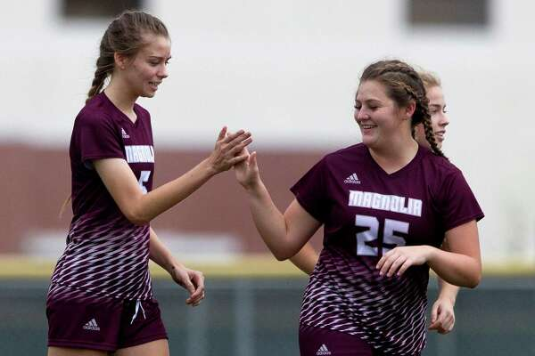 Magnolia midfielder Breane Podhaisky (5), left, celebrates with defenseman Jaycee Fraser (25) after scoring a goal against Angleton during the first period of a high school girls soccer match in the Texans Drive Tournament at Porter High School Friday, Jan. 20, 2017, in Porter.