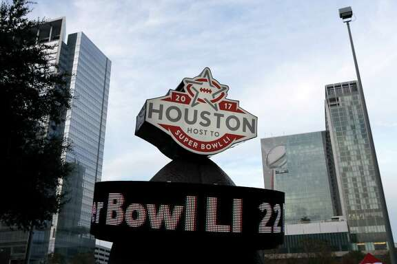 This Jan. 14, 2017 photo shows a countdown sign leading up to Super Bowl LI in Discovery Green park in downtown Houston. Super Bowl LI will be played Feb. 5 at NRG Stadium in Houston. (AP Photo/David J. Phillip)