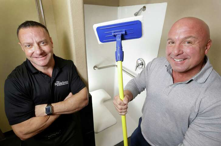 Mike Smith, left, and Bill Manovich with The Simple Scrub, a bathtub and shower scrubber. They got a chance to pitch the product to executives from Good Housekeeping and HSN.