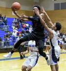 Westfield's Jase Febres goes up for a layup to score two of his 12 points in Friday's win over Dekaney.