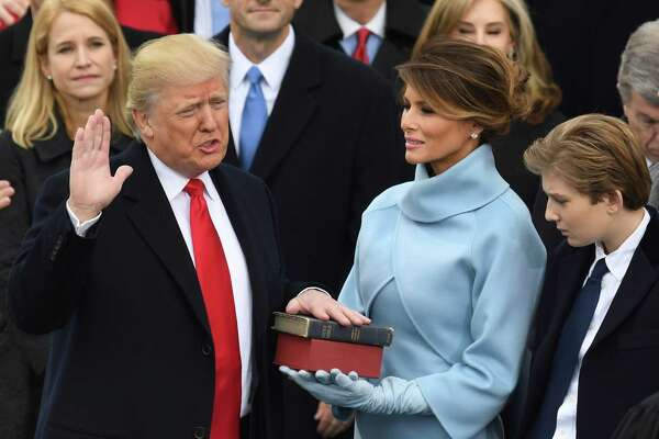 TOPSHOT - US President-elect Donald Trump is sworn in as President on January 20, 2017 at the US Capitol in Washington, DC. / AFP PHOTO / Mark RALSTONMARK RALSTON/AFP/Getty Images ORG XMIT: Inaugurat