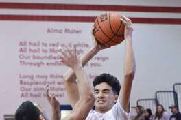 Martin's Eduardo Vela and the Tigers picked up a close 51-48 road win on Friday night at Valley View to move to 10-0 in District 31-5A.