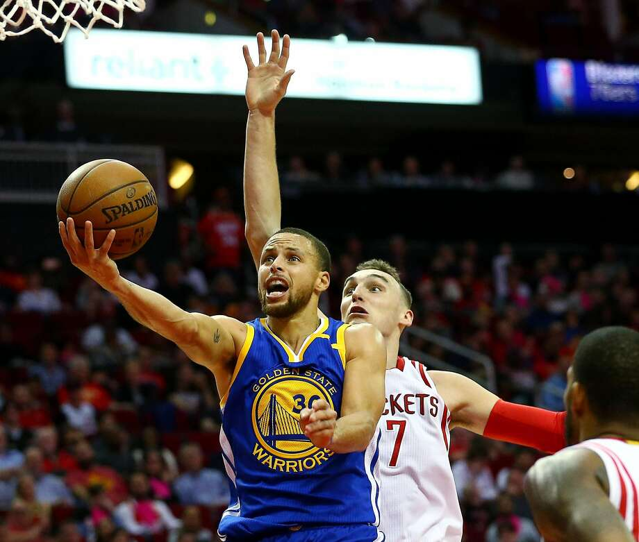 Golden State Warriors guard Stephen Curry (30) goes past Houston Rockets forward Sam Dekker (7) for a layup during the third quarter of an NBA game at the Toyota Center Friday, Jan. 20, 2017, in Houston. ( Jon Shapley / Houston Chronicle ) Photo: Jon Shapley, Houston Chronicle
