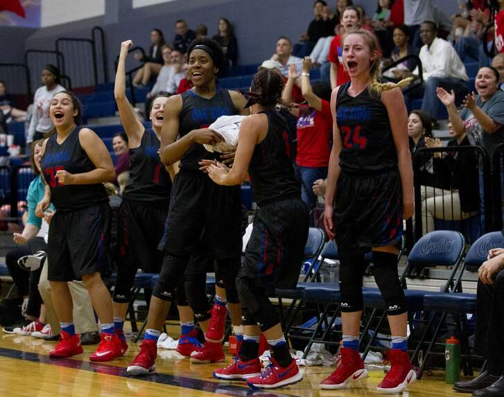 Oak Ridge players celebrate after a basket during the third quarter of a District 16-6A high school girls basketball game at College Park High School Friday, Jan. 20, 2017, in The Woodlands. Oak Ridge defeated College Park 56-39.