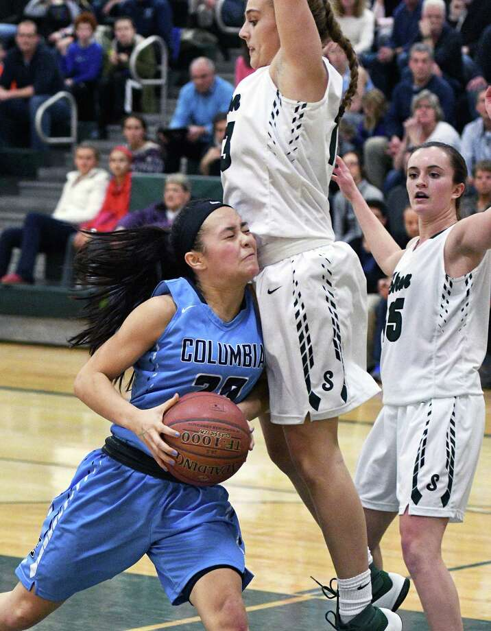 Columbia's #20 Emily Zeyak, left, crashes into  Shen's #13 Jessica Wagoner for a rebound during Friday night's game for first place in the Suburban Council Blue Division Jan. 20, 2017 in Clifton Park, NY.  (John Carl D'Annibale / Times Union) Photo: John Carl D'Annibale / 20039437A