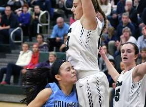 Columbia's #20 Emily Zeyak, left, crashes into  Shen's #13 Jessica Wagoner for a rebound during Friday night's game for first place in the Suburban Council Blue Division Jan. 20, 2017 in Clifton Park, NY.  (John Carl D'Annibale / Times Union)