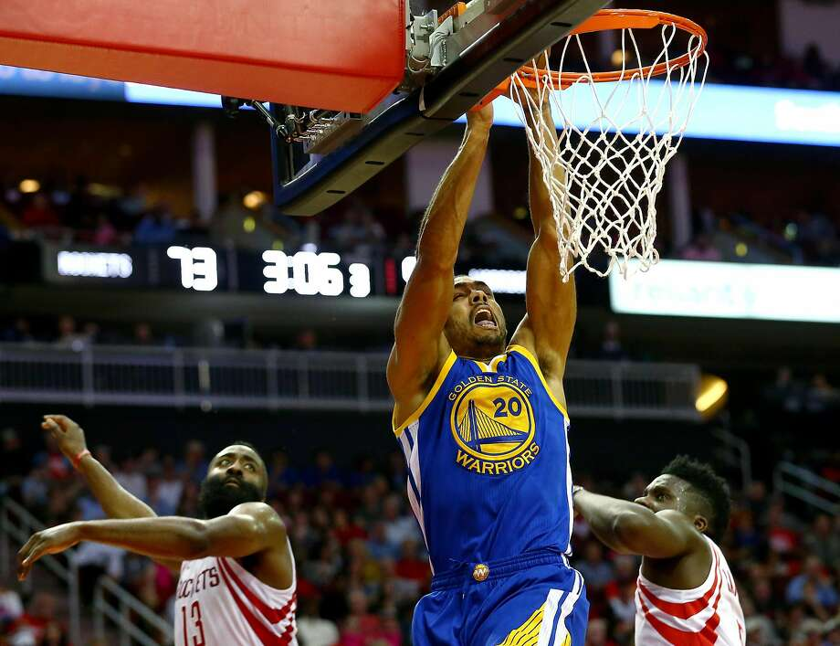 Golden State Warriors forward James Michael McAdoo (20) gets past Houston Rockets guard James Harden (13) and center Clint Capela (15) on his way to the basket during the third quarter of an NBA game at the Toyota Center Friday, Jan. 20, 2017, in Houston. ( Jon Shapley / Houston Chronicle ) Photo: Jon Shapley, Houston Chronicle