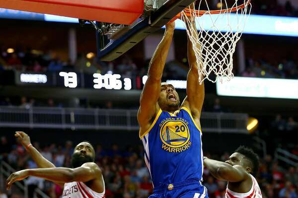 Golden State Warriors forward James Michael McAdoo (20) gets past Houston Rockets guard James Harden (13) and center Clint Capela (15) on his way to the basket during the third quarter of an NBA game at the Toyota Center Friday, Jan. 20, 2017, in Houston. ( Jon Shapley / Houston Chronicle )