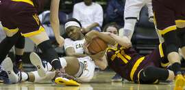 California�s Mi�Cole Cayton (21) and Arizona State�s Robbi Ryan (11) wrestle for a loose ball during the fourth quarter of an NCAA women's college basketball game, on Friday, Jan. 20, 2017 in Berkeley, Calif. Arizona State won 54-45.