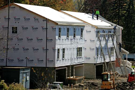FILE - In this Nov. 10, 2016, file photo, construction continues on new homes in Canonsburg, Pa. On Thursday, Jan. 19, 2017, the Commerce Department reports on U.S. home construction in December. (AP Photo/Gene J. Puskar, File)