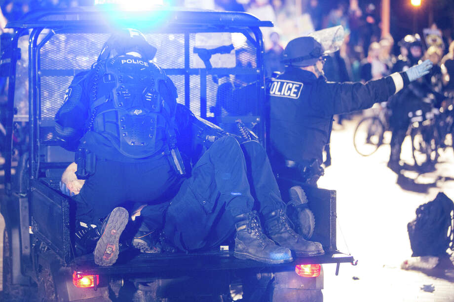 Police tend to a protester who was shot during a confrontation with hopeful attendees of controversial Breitbart.com editor Milo Yiannopoulos' speech at University of Washington on Friday, Jan. 20, 2016 Photo: GRANT HINDSLEY, SEATTLEPI.COM / SEATTLEPI.COM