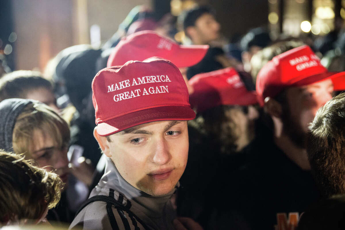 A group of Trump supporters waits in hopes of seeing controversial Breitbart.com editor Milo Yiannopoulos at University of Washington on Friday, Jan. 20, 2016