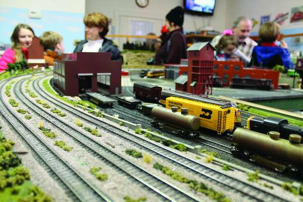 The Metro East Model Railroad Club conducted three open houses – Dec. 3, Dec. 17 and Dec. 31 – during the holidays at their facility inside the old Glen Carbon Firehouse/Village Hall on Summit Street. The massive HO scale layout will be on display again at an undetermined date in March. The open houses are free to the public. The trains and layout have a local feel, with the railroads that ran through Glen Carbon well represented. Local landmarks, like Peters Station, are featured, too. Also of note, one of the engines that laps the layout has a tiny camera located in its nose. A video feed of the train navigating its way around the track is then projected onto an overhead television.