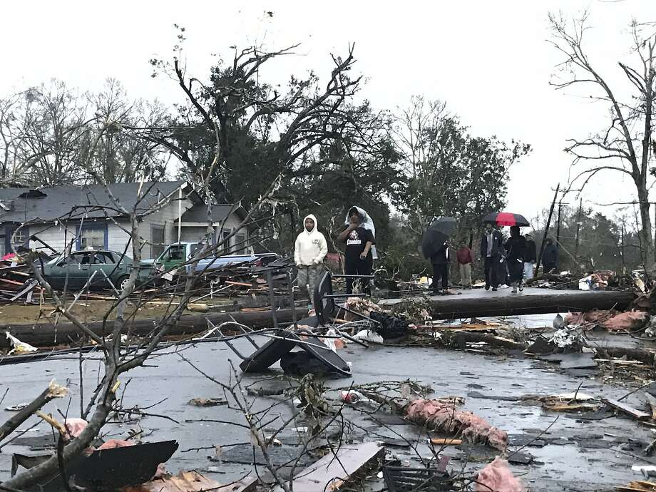 Trees and debris from damaged homes litter the ground after a tornado tore through the Hattiesburg, Miss., region. Photo: Ryan Moore, Associated Press