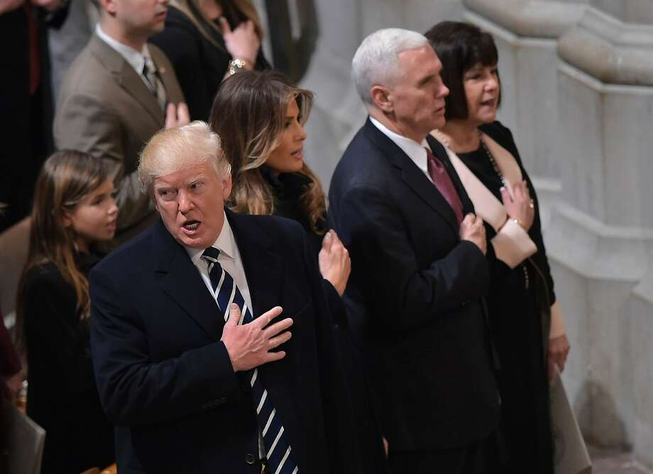 (L-R) US President Donald Trump, First Lady Melania Trump,  Vice President Mike Pence and Karen Pence attend the National Prayer Service at the National Cathedral on January 21, 2017, in Washington, DC. / AFP PHOTO / Mandel NGANMANDEL NGAN/AFP/Getty Images Photo: MANDEL NGAN, AFP/Getty Images