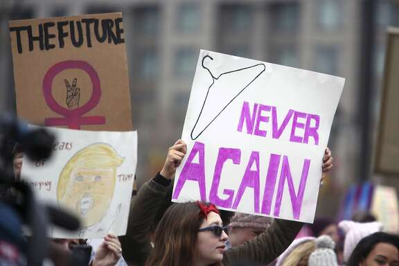Protesters prepare to rally at the Women's March Saturday Jan. 21, 2017 in Philadelphia.  The march is being held in solidarity with similar events taking place in Washington and around the nation. (AP Photo/Jacqueline Larma)
