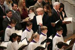 WASHINGTON, DC - JANUARY 21:  U.S. President Donald Trump stands with his wife first lady Melania Trump, Vice President Mike Pence, and his wife Karen Pence. during the National Prayer Service at the National Cathedral, on January 21, 2017 in Washington, DC.  (Photo by Mark Wilson/Getty Images)