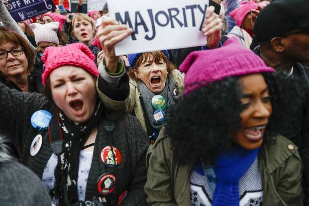Protesters cheer at the Women's March on Washington during the first full day of Donald Trump's presidency, Saturday, Jan. 21, 2017 in Washington. Organizers of the Women's March on Washington expect more than 200,000 people to attend the gathering. Other protests are expected in other U.S. cities. (AP Photo/John Minchillo)