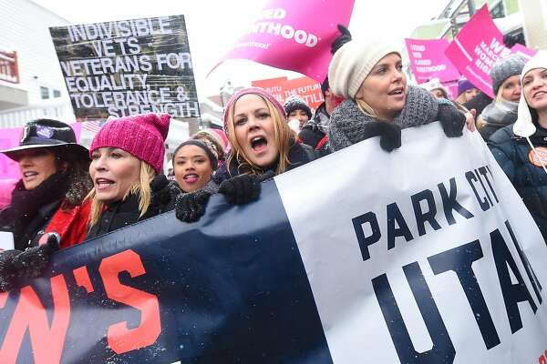 PARK CITY, UT - JANUARY 21:  Chelsea Handler, Maria Bello and Charlize Theron participates in the Women's March on Main Street Park City on January 21, 2017 in Park City, Utah.  (Photo by Michael Loccisano/Getty Images)