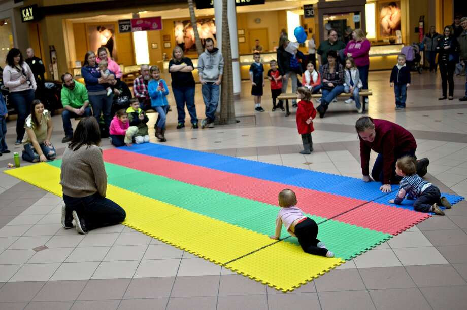 Babies prepare to start a race during the 2017 Diaper Derby on Saturday at the Midland Mall. The Diaper Alliance hosted the event as part of Kids Day at the Mall. Babies raced two at a time on a mat in heats to determine the champion. Photo: NICK KING | Nking@mdn.net