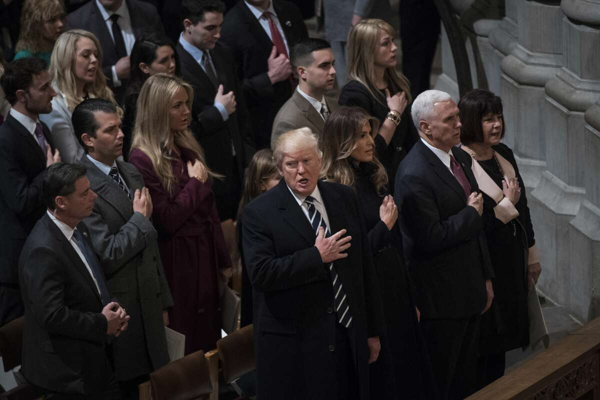 President Donald Trump with first lady Melania Trump, Vice President Mike Pence, and his wife Karen Pence, listen during the National Prayer Service at the Washington National Cathedral in Washington on January 21, 2017.