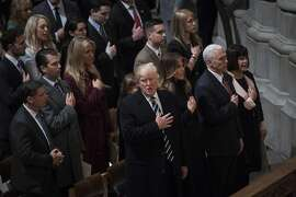 President Donald Trump with first lady Melania Trump, Vice President Mike Pence, and his wife Karen Pence, listen during the National Prayer Service at the Washington National Cathedral in Washington on January 21, 2017. MUST CREDIT: Photo by Jabin Botsford-The Washington Post