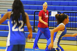 Klein Lady Bearkats head coach Jackie Edwards runs drills in practice last week. Edwards has engineered a remarkable turnaround, taking a team that finished last in district last season and racing out to a 9-0 start this season.