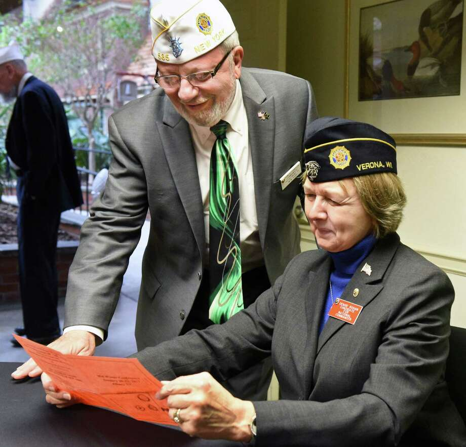 John Sampson, commander of the American Legion Department of New York, and the leading candidate for 2017-2018 American Legion national commander Denise Rohan of Wisconsin, look over the program at their Mid-Winter Conference Saturday Jan. 21, 2017 in Colonie, NY.  (John Carl D'Annibale / Times Union) Photo: John Carl D'Annibale / 20039498A