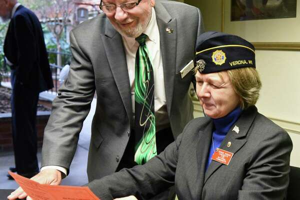 John Sampson, commander of the American Legion Department of New York, and the leading candidate for 2017-2018 American Legion national commander Denise Rohan of Wisconsin, look over the program at their Mid-Winter Conference Saturday Jan. 21, 2017 in Colonie, NY.  (John Carl D'Annibale / Times Union)