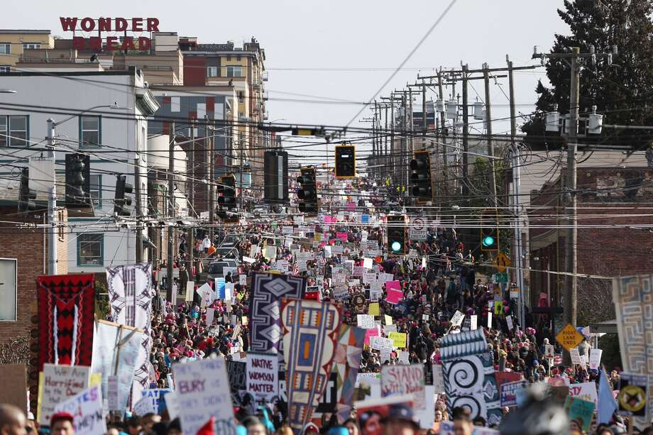Women's March on Seattle participants move through the city's core on their way to Seattle Center on Saturday, Jan. 21, 2017.