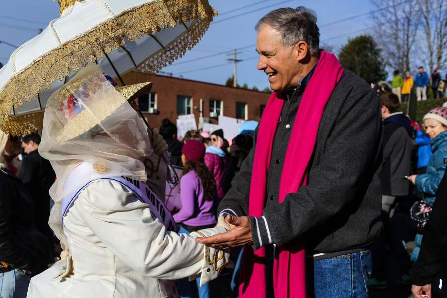 """Gov. Jay Inslee greets a marcher at the Women's March on Seattle, Saturday, Jan. 21, 2017. Inslee has condemned acts of hate, welcomed Syrian refugees, and condemned President Trump's Muslim bans. He describes vandalism at Temple De Hirsch Sinai as """"the latest in a wave of anti-Semitic threats against our state's Jewish community.""""  Photo: GENNA MARTIN, SEATTLEPI.COM"""