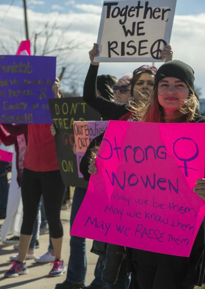 """FILE PHOTO: Demonstrators come together on the sidewalk along Midkiff Road outside Midland Park Mall to raise their voice in a solidarity """"march"""" with the Women's March on Washington.  Tim Fischer/Reporter-Telegram Photo: Tim Fischer/Midland Reporter-Telegram"""