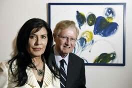 Brita Darany von Regenburg and her husband, Tibor Darany, pose in front of a painting by their autistic daughter, Vanessa, inside their home in Greenwich, Conn. Tuesday, Jan. 17, 2017. Brita is the president of Friends of Autistic People (FAP) and Tibor is on the Board of Directors. Vanessa lives at a group home in Trumbull and the couple goes to visit her there every weekend.