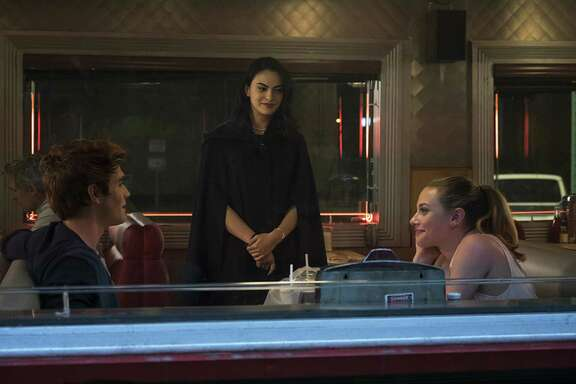 """""""Riverdale"""" is a noir update to the """"Archie"""" comic. The CW show stars, from left, K.J. Apa as Archie, Camila Mendes as Veronica and Lili Reinhart as Betty."""