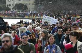 Thousands of participants walk past Lake Merritt in the Women's March in Oakland, Calif. on Saturday, Jan. 21, 2017 which was organized along with others around the country as a show of unity after yesterday's inauguration of President Donald Trump.