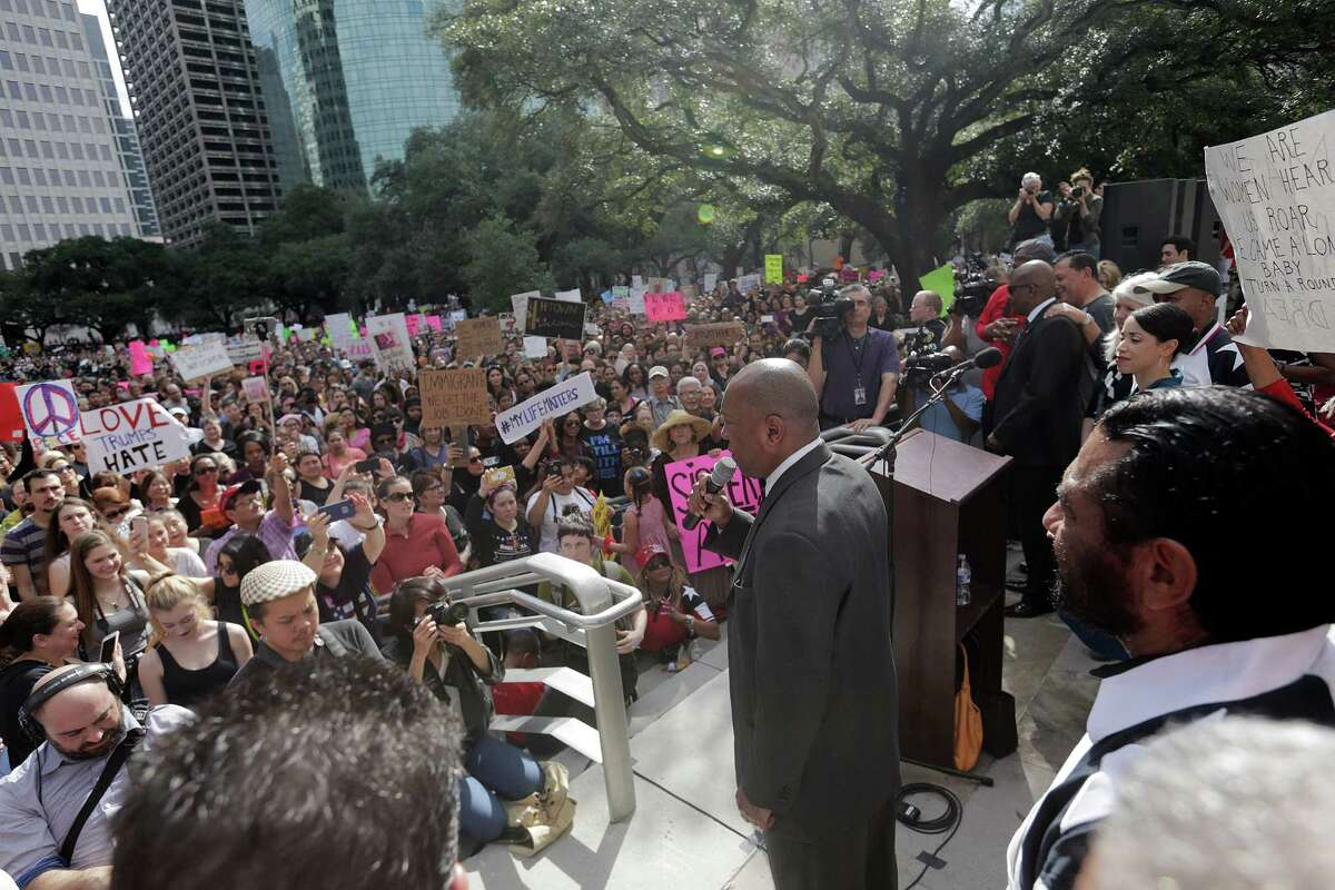 Houston Mayor Sylvester Turner addresses marchers outside City Hall on Saturday, Jan. 21, 2017, in Houston.