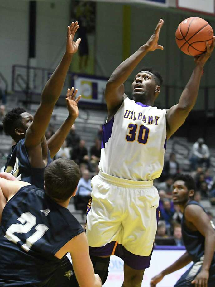 University at Albany's Travis Charles goes up for a shot during a basketball game against New Hampshire at SEFCU Arena on Wednesday, Jan. 11, 2017 in Albany, N.Y. (Lori Van Buren / Times Union) Photo: Lori Van Buren / 20039283A