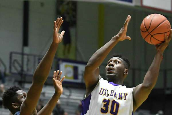 University at Albany's Travis Charles goes up for a shot during a basketball game against New Hampshire at SEFCU Arena on Wednesday, Jan. 11, 2017 in Albany, N.Y. (Lori Van Buren / Times Union)