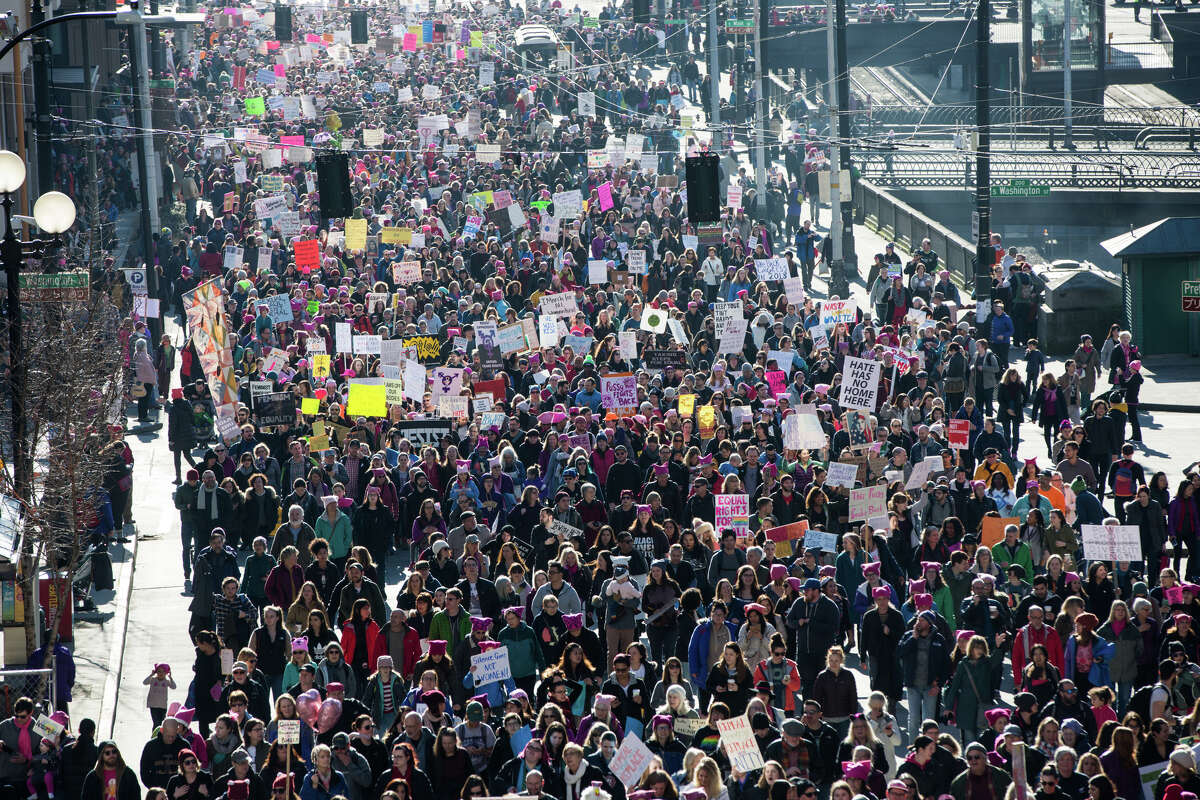 Thousands walk along Fourth Avenue in the Women's March on Seattle on Saturday, Jan. 21, 2017.
