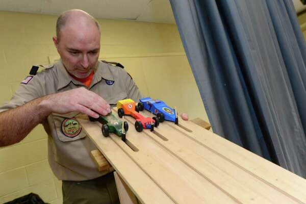 Bear Leader Patrick Pons lines up the cars during the Cub Scout Pack 97's annual Pinewood Derby on Saturday, January 21, 2017,  at St Jerome's Church in Norwalk, Conn.