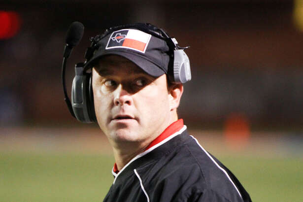 Levelland head coach Jared Sanderson looks over his shoulder during the second quarter. Levelland High School played Wylie High School in the 4A Quarterfinals at San Angelo Stadium Friday, December 30, 2016, in San Angelo, Texas. (Mark Rogers/AJ Media)