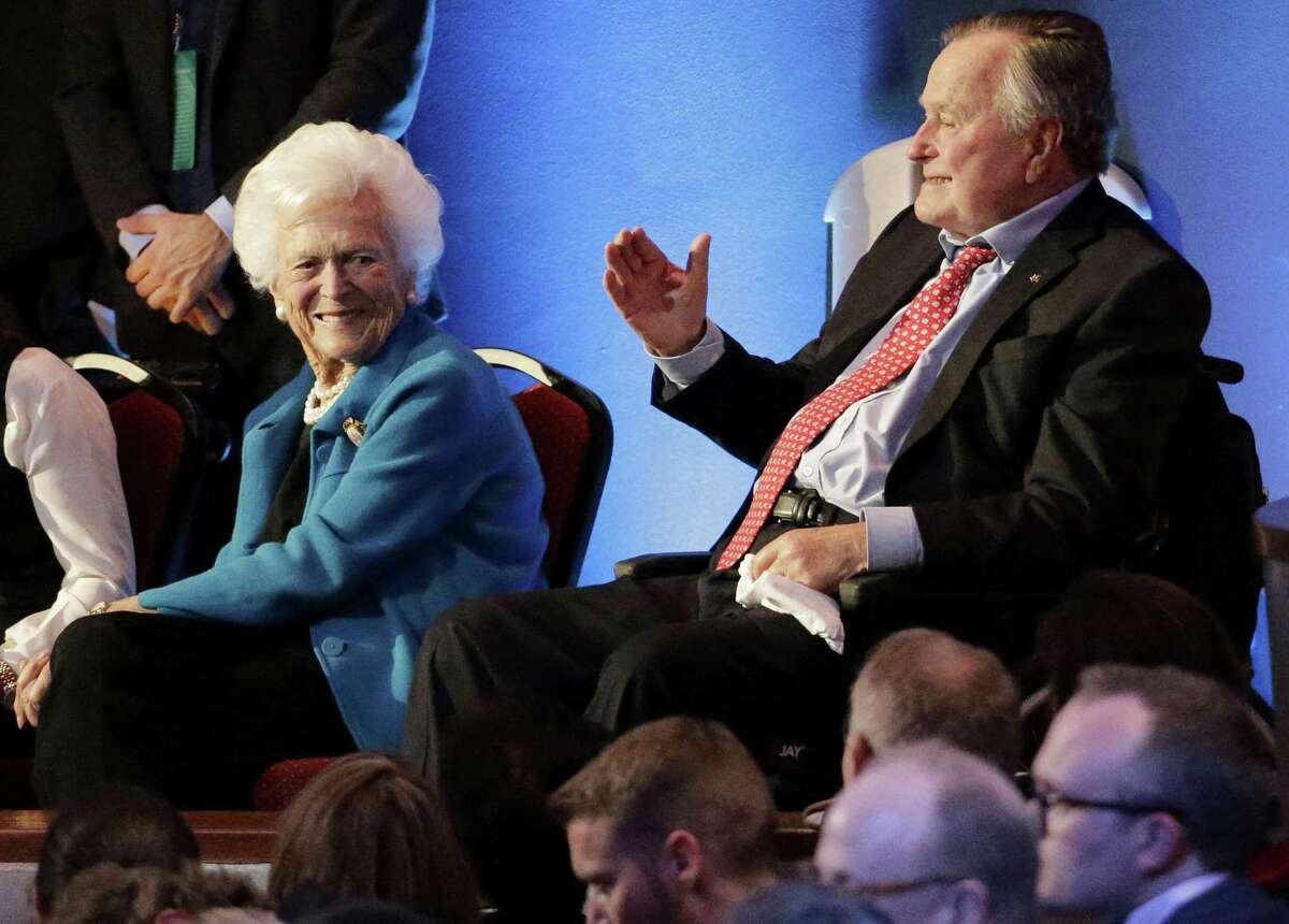 FILE - In this Thursday, Feb. 25, 2016 file photo, former President George H. W. Bush, right, and his wife, Barbara, are greeted before a Republican presidential primary debate at The University of Houston in Houston. On Wednesday, Jan. 18, 2017, the former president was admitted to an intensive care unit, and Barbara was hospitalized as a precaution, according to his spokesman. (AP Photo/David J. Phillip)